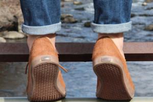 My friend tiptoeing on a bridge
